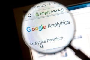 Google analytics website under a magnifying glass - Big Easy SEO