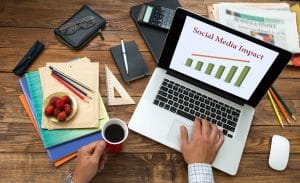Social Media Consultant Working at Wooden Desk - Big Easy SEO